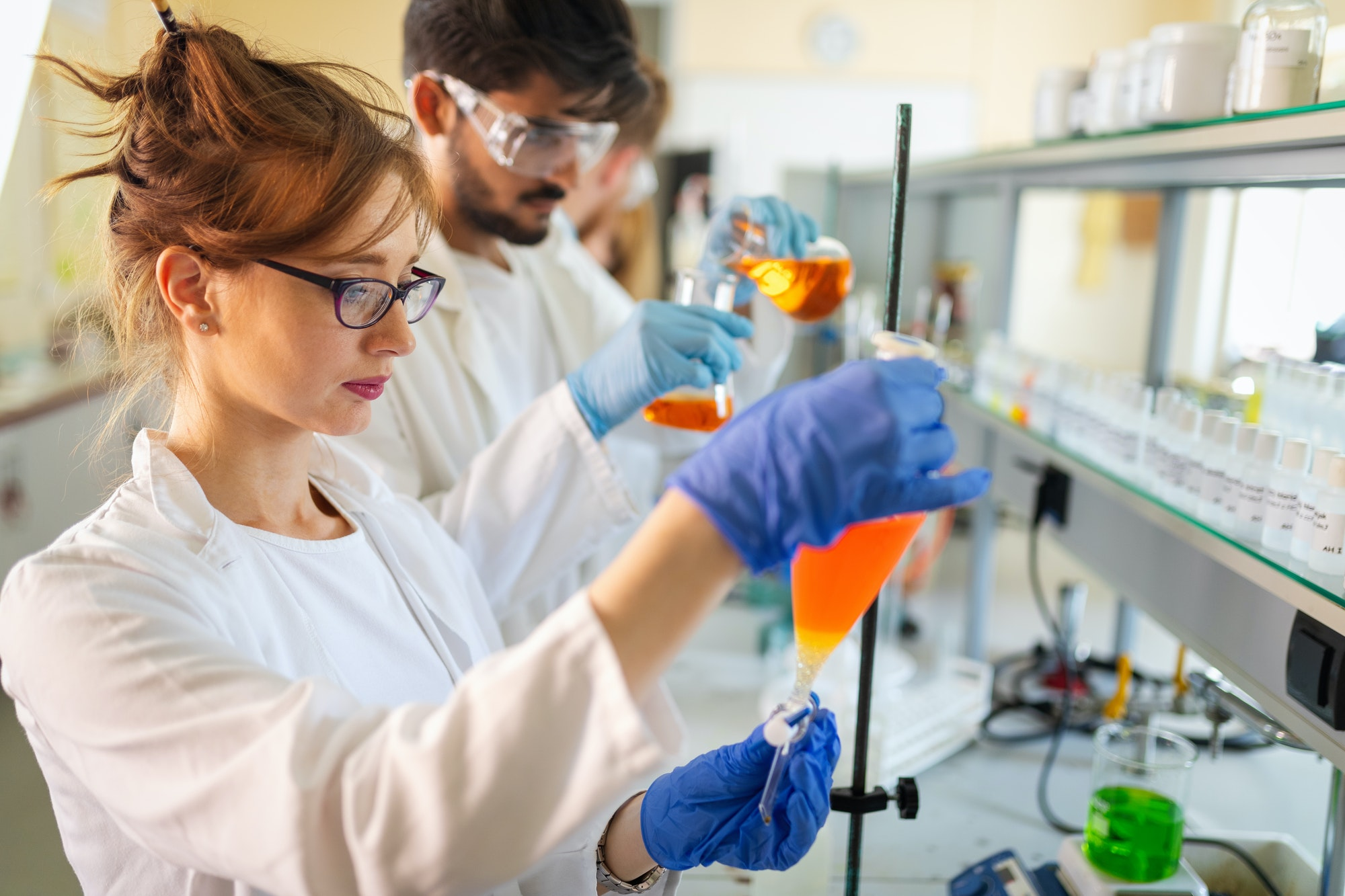 Group of medical research scientists collectively working in laboratory